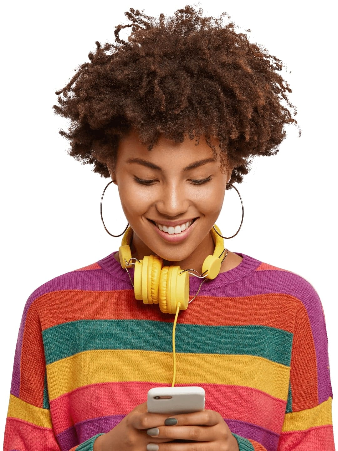 An image of a woman in a brightly colored sweater with yellow headphones, smiling while choosing a podcast to listen to on her mobile phone.